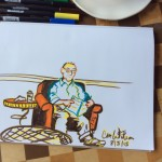 Guy Reading in a Cafe